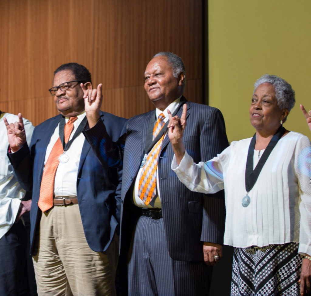 Willie C. Jordan stands with a group of UT Precursors